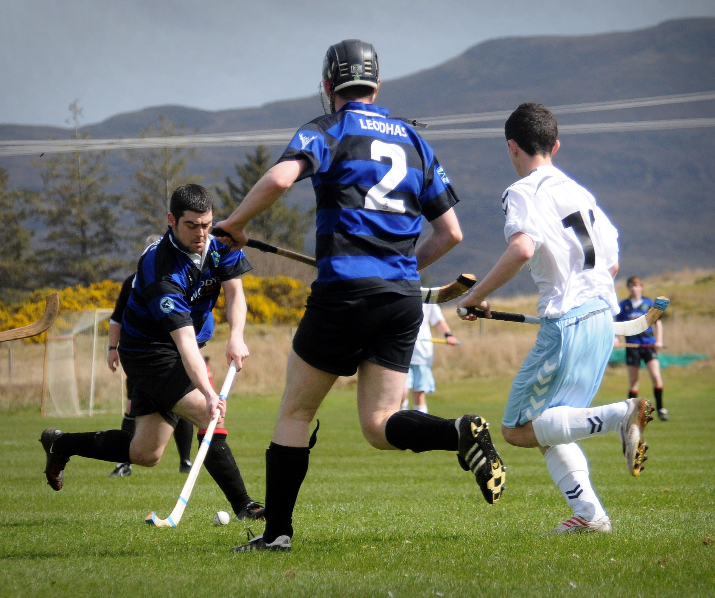 Lewis captain on the ball against Skye